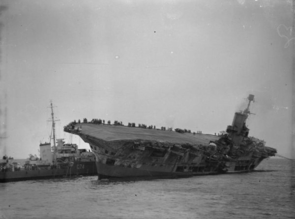 HMS Legion alongside the listing HMS Ark Royal
